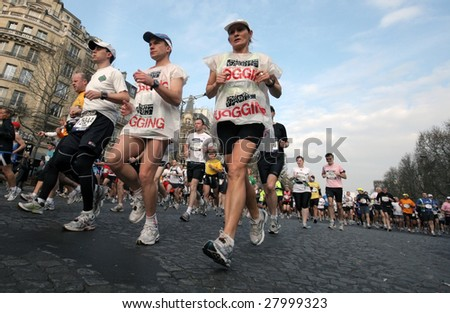 PARIS - APRIL 5: 31,373 people took part in the annual Paris Marathon, which started off from Arch of Triumph and ran through the city of Paris April 5, 2009 in Paris, France. - stock photo