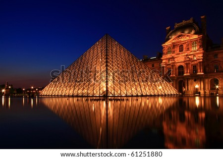 PARIS-APRIL 16: Reflection of Louvre pyramid shines at dusk during the Summer Exhibition April 16, 2010 in Paris.Louvre is the biggest Museum in Paris displayed over 60,000 sqr.m of exhibition space.
