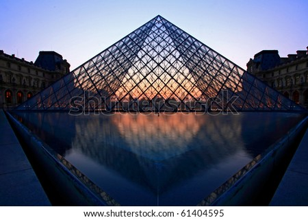 PARIS-APRIL 16: Silhouette of Louvre pyramid at Evening during the Egyptian Antiquities Exhibition April 16, 2010 in Paris. Louvre is the biggest Museum in Paris displayed over 60,000 Sqr.m of exhibition space.