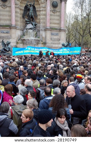 PARIS - APRIL 8: Thousands of people gathered to protest the law, which prohibits to provide aid and support to illegal immigrants in France on April 8, 2009 at Place St. Michel in Paris, France