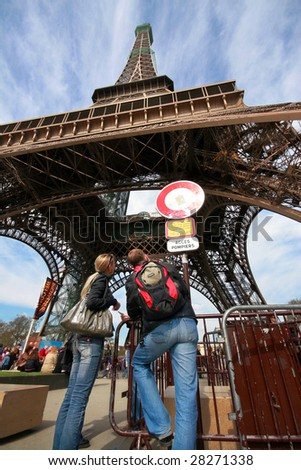 PARIS- APRIL 10: Tourists are back to visit Eiffel Tower after 1,5 day strike, where personnel demanded better work conditions, April 10, 2009 in Paris. 500 workers daily service ca 18,000 tourists.