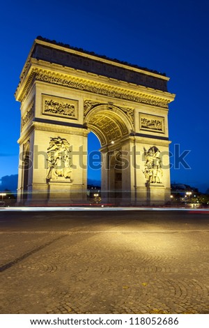 Paris, Arc de Triomphe by night with strips of vehicles
