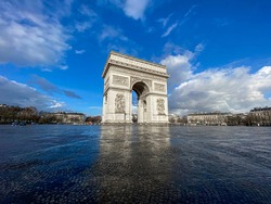 Paris, arc de triomphe during a sunny and cloudy day