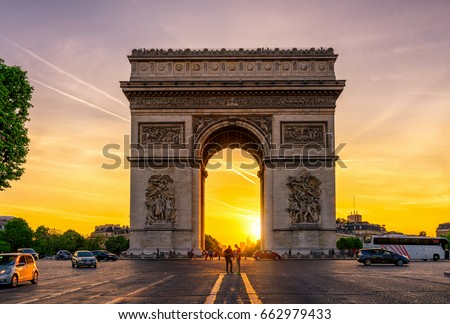 Paris Arc de Triomphe (Triumphal Arch) in Chaps Elysees at sunset, Paris, France. Architecture and landmarks of Paris. Postcard of Paris #662979433