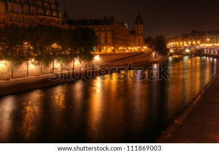 Paris at night: river Seine and illuminated riverbank at Ile de la Cite.