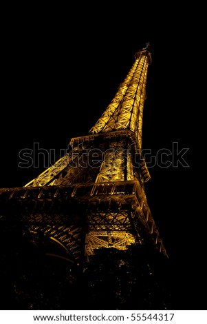 PARIS - AUGUST 7: Eiffel tower at night on August 7, 2010 in Paris. The Eiffel tower is the most visited monument of France.