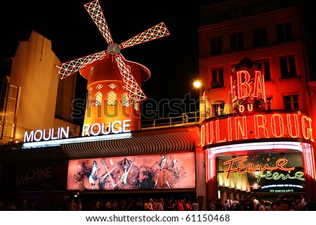 PARIS - AUGUST 23: People queue for tickets in front of The Moulin Rouge, famous cabaret and theater on August 23, 2010 in Paris, France.