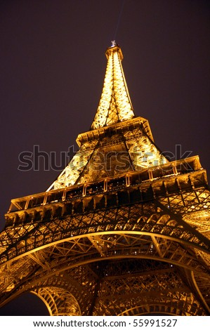 PARIS - AUGUST 9: The Eiffel Tower sparkles at night August 9, 2007 in Paris, France - stock photo