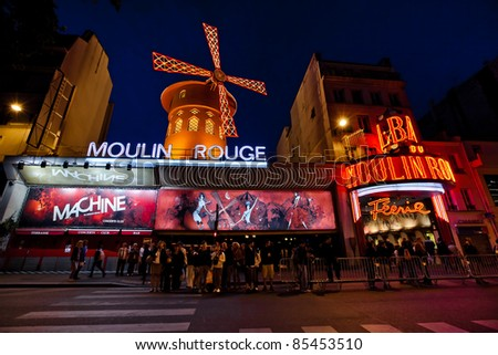 PARIS - AUGUST 29: The Moulin Rouge by night, on August 29, 2011 in Paris, France. Moulin Rouge is a famous cabaret built in 1889, locating in the Paris red-light district of Pigalle