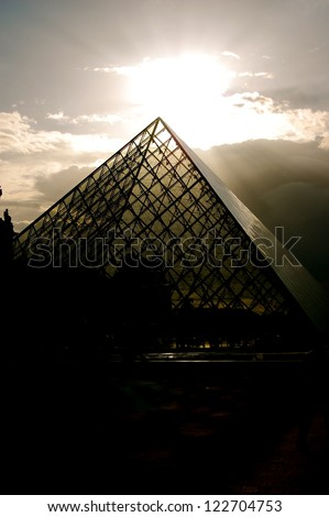 PARIS - AUGUST 17: The sun sets on over the Louvre Museum's Glass Pyramid on August 17, 2008 in Paris, France.