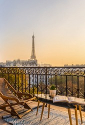 paris balcony with splendid view on eiffel tower at sunset