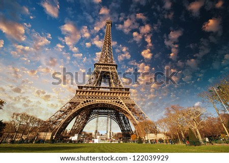 Paris. Beautiful view of Eiffel Tower with sky sunset colors.