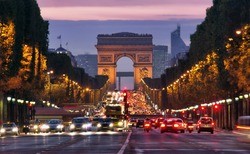 Paris, Champs-Elysees at night. Car traffic jam on street near Arc de Tripmphe. pollustion concept or stop diesel fuel for the environment. save the planet Earth. France