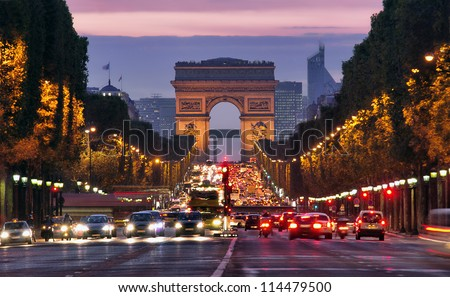 Photo of Paris, Champs-Elysees at night. Car traffic jam on street near Arc de Tripmphe. pollustion concept or stop diesel fuel for the environment. save the planet Earth. France