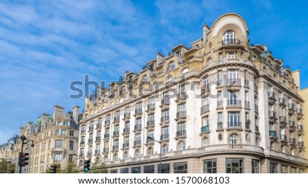 Paris, charming street and buildings, typical parisian facades in the Marais   #1570068103
