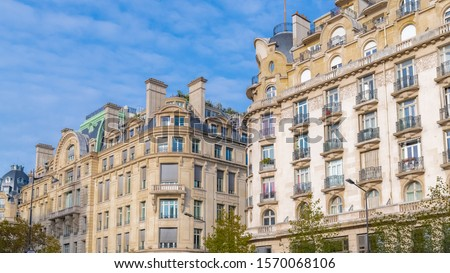 Paris, charming street and buildings, typical parisian facades in the Marais   #1570068106