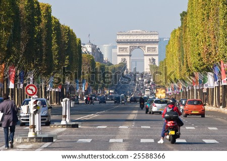 PARIS- CIRCA JULY 2007: Vehicles travel along Champs Elysees - one of a famous touristic attractions in Paris.