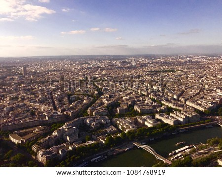 Paris Cityscape from Top of Eiffel Tower with hazy bluesky