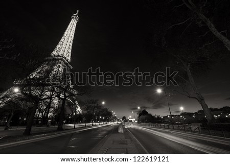 PARIS - DEC 1: Eiffel Tower shows its wonderful lights at sunset with car light trails, December 1, 2012 in Paris. The Tower is lit by more than 350 lamps mounted within the structure of the tower.