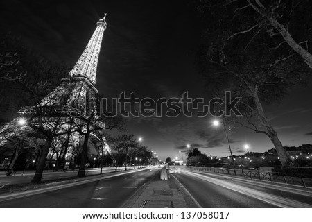 PARIS - DEC 1: Eiffel Tower shows its wonderful lights at sunset with car trails, December 1, 2012 in Paris. The Tower is lit by more than 350 lamps mounted within the structure of the tower itself