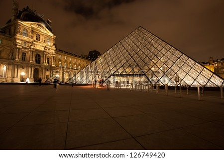PARIS - DEC. 3: The Louvre Art Museum on December 3, 2010 in Paris. The history of this most famous museum goes back 800 years of continuous transformations from fortress to palace and museum.