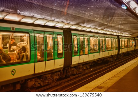 PARIS, DEC 4: Underground train inside a metro station, December 4, 2012 in Paris. Paris Metro is the 2nd largest underground system worldwide by number of stations (300)