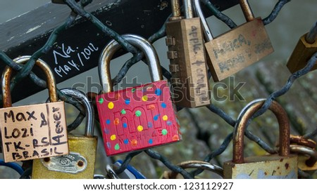 PARIS - DECEMBER 9: Colorful funny love lock as seen on December 9, 2012 in Paris, France. Ritual of affixing padlocks, as symbol of love, to bridge's fence started to spread in Europe in early 2000s.