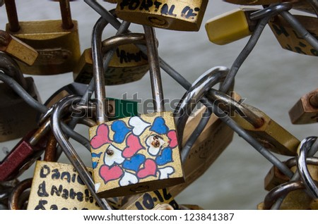 PARIS - DECEMBER 9: Colorful heart decorated love lock as seen on December 9, 2012 in Paris, France. Ritual of affixing padlocks, as symbol of love, to bridge is spread in Europe from 2000s.