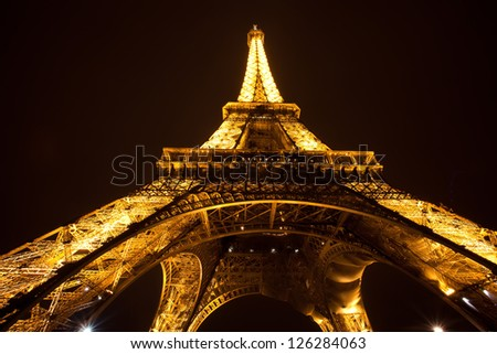 PARIS - DECEMBER 4 : Eiffel tower at night, December 4, 2010 in Paris. The tower is the tallest structure in Paris and the most-visited paid monument in the world.