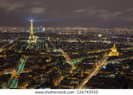 PARIS - DECEMBER 29: Eiffel tower at night view from Montparnasse Tower on December 29, 2013 in Paris. The Eiffel tower is the most visited monument of France