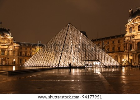PARIS - DECEMBER 9: Louvre museum in Paris, France at night on December 9, 2009. Louvre is the biggest museum in Paris with over 60,000 square meters of exhibition space.