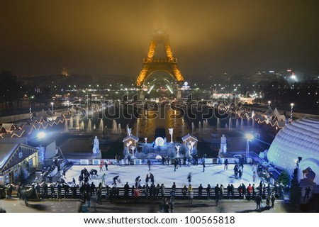 PARIS - DECEMBER 27: People ice skating at night in front of Eiffel Tower on December 27, 2012 in Paris, France. Eiffel Tower is the highest iconic monument in France.