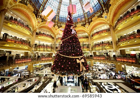 PARIS - DECEMBER 30: The Christmas tree at Galeries Lafayette, trade pavilions with perfume, December 30, 2009, Paris, France. Many famous perfume brands represent their production here.