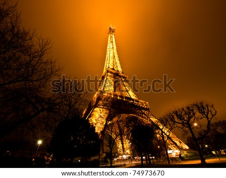 PARIS - DECEMBER 2: the Eiffel tower on  DECEMBER 2, 2010 in Paris, France. Built in 1889, it has become both a global icon of France and one of the most recognizable structures in the world.