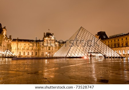 PARIS - DECEMBER 7: The Louvre Museum at the rainy night on December 7, 2010 in Paris France.The Louvre is the biggest Museum in Paris displayed over 60,000 square meters of exhibition space.