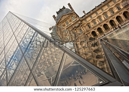 PARIS - DECEMBER 08: Unusual view of Louvre Pyramid on December 08, 2012 in Paris, France. Louvre is the biggest Museum in Paris displayed over 60,000 square meters of exhibition space.