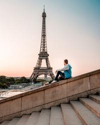 Paris Eifel tower France, men watching Sunrise by Eifel tower Paris