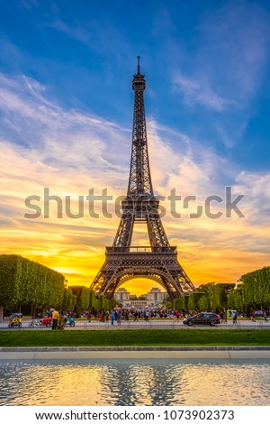 Paris Eiffel Tower and Champ de Mars in Paris, France. Eiffel Tower is one of the most iconic landmarks in Paris. The Champ de Mars is a large public park in Paris. #1073902373