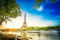 Paris Eiffel Tower and famous river Seine at sunrise in Paris, France. Eiffel Tower is one of the most iconic landmarks of Paris, retro toned