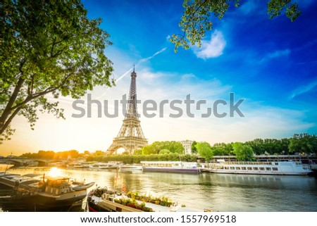Paris Eiffel Tower and famous river Seine at sunrise in Paris, France. Eiffel Tower is one of the most iconic landmarks of Paris, retro toned Stock photo ©