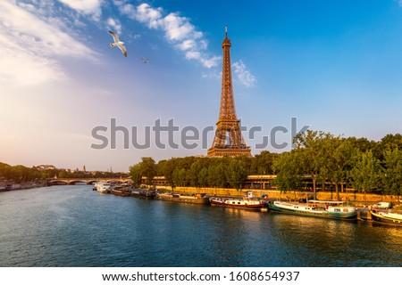 Paris Eiffel Tower and river Seine at sunset in Paris, France. Eiffel Tower is one of the most iconic landmarks of Paris. Eiffel tower in summer, Paris, France.