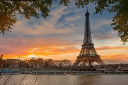 Paris Eiffel Tower and river Seine in Paris, France. Eiffel Tower is one of the most iconic landmarks of Paris