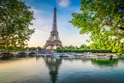 Paris Eiffel Tower and river Seine with sunrise in Paris, France. Eiffel Tower is one of the most iconic landmarks of Paris., toned
