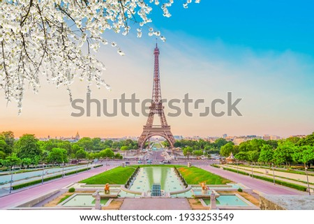 Paris Eiffel Tower and Trocadero garden at spring sunset in Paris, France. Eiffel Tower is one of the most famous landmarks of Paris., toned