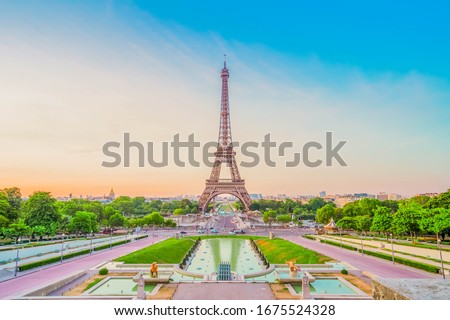 Paris Eiffel Tower and Trocadero garden at sunset in Paris, France. Eiffel Tower is one of the most famous landmarks of Paris., toned