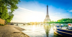 Paris Eiffel Tower reflecting in river Seine at sunrise in Paris, France. Web banner format. Eiffel Tower is one of the most iconic landmarks of Paris, retro toned