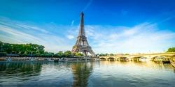 Paris Eiffel Tower reflecting in river Seine with bridge Pont dIena in Paris, France. Eiffel Tower with sunshine