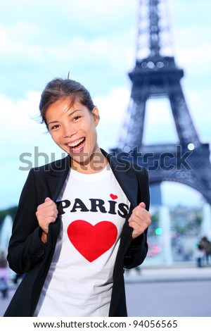 Paris Eiffel tower woman happy and excited in front of the Eiffeltower, Paris, France.