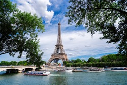 Paris famous landmarks. Eiffel Tower iwith green tree over river, Paris France