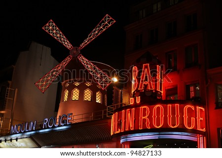 PARIS - FEBRUARY 2: The Moulin Rouge by night, on February 2, 2012 in Paris, France. Moulin Rouge is a famous cabaret built in 1889, locating in the Paris red-light district of Pigalle